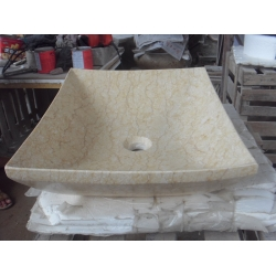 beige color marble sink and basin
